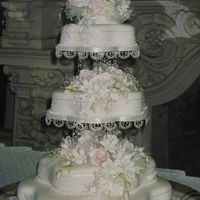 Victorian Wedding Cake served 150 people. It was designed to match the brides dress.