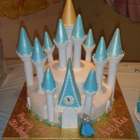 Cinderella's Castle This is a 2 tier cake covered in fondant and along w/ the castle towers by wilton.