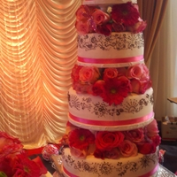 Wedding Cake- India This is a 4 tier, with an extra tier in each side, made for an India style wedding.Henna design on fondant through out each tier, made by...