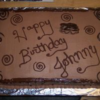 Lots Of Choc. a big choc and vanilla cake with choc. bc and choc swirls and writing. A big cake for a big ol' boy!!!!!