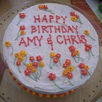 Birthday_Cake.jpg Cake decorated with red and orange/yellow drop flowers for my sister-in-law and my husband's birthdays. It was a hit, mostly because...