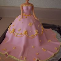 Barbie Cake This was my first doll cake, first ust of fondant (we used a recipe from cc and it turned out fabulous!), and first try at making drop...