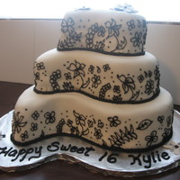 Sweet Sixteen Paisley cake pans, cake was covered in white fondant and hand piped with royal icing