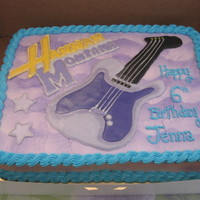 "Hannah Montana Buttercream sheetcake, ""Hannah Montana"" and guitar are a color flow plaque."