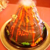 "Volcano Eruption Cake My first volcano cake! 6-layers with vanilla buttercream, dry ice 'smoke'. ""Sublimation....straight from a solid to a gas.&..."