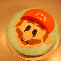 Mario Cake!! So fun to make. Haha. I'm always happy to get a mario order! (first time) :] He's fondant on top of some good ol'...