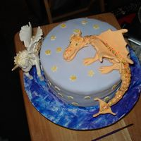 Fantasy Cake The wings on the unicorn had a mind of thier own...lol all fondant...2 characters from debbie brown