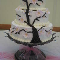 Cherry Blossom Tree Three tiered dummy cake made of rice crispies. Display cake for my Grandmother's 99th Birthday party! Cupcakes with cherry blossoms...