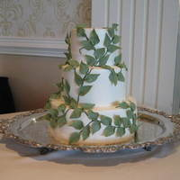Green Leaves Wedding Leaves were made from fondant, with luster dust. This was for a Kentucky Derby Themed wedding and was lots of fun!Cake was French Vanilla...