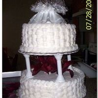 Basketweave Wedding Cake This is my first wedding cake that I made for a friend of mine. Top Tier is Banana bottom White Almond Sour Cream. They loved it!