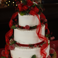 Christmas Wedding Cake 3 tiered round wedding cake with buttercream frosting.