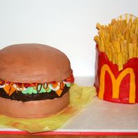 Burger And Fries I made this for a friends baby shower.The fry cake is carrrot cake and all fondant .The burger is yellow and chocolate cake with...