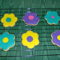 Flower Cookies I made these cookies as practice. They are covered in thinned royal icing.