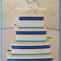 "Simple Lines 6"" 8"" 10"" & 12"" covered in buttercream with teal and purple ribbon and rhinestone border. Gumpaste callas and..."