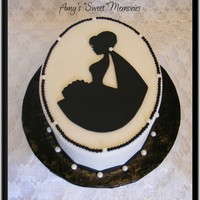 "Here Comes The Bride 7"" oval wasc covered in buttercream with fondant handcut image and trim and edible pearls."