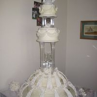 "First Wedding Cake An adaptation of Wilton's Granduer from Tiered Cakes publication. 18"" half classic wedding cake, half devils food. 12""..."