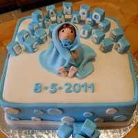 Baby Blue Christianing cake. Vanilla Sponge cake, covered in fondant. Baby and building blocks also fondant.