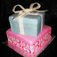 Coach Gift Box Cake This is a 2 tier butter cake covered in fondant. The top tier is a gift box in the Tiffany Box style, the bottom tier is a Coach Gift Box....