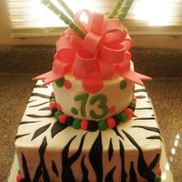 Zebra And Polka Dot Cake This cake was so fun. The bottom tier is 3 layers of zebra striped chocolate and butter cake with chocolate ganache filling. The top tier...