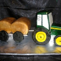 John Deere Tractor With Trailer And Round Hay Bales  The tractor is carved buttercake covered in fondant with rice crispy treats for wheels. The trailer is chocolate cake covered in fondant...