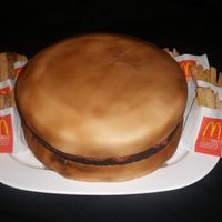 "Hamburger Cake With Sugar Cookie Fries  The bun is a 14"" butter cake covered in buttercream and then fondant. Then airbrushed. The Hamburger is a brownie that I baked in the..."