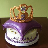Purple + Gold Tiara Cake Royal Icing tiara on fondant covered cushion cake on an imbc covered WASC:) Big thx to all CC for inspiration and tips:)