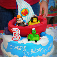 Wonder Pets To The Rescue! Sailboat is a carved cake with a fondant and gumpaste sail, and Wonder Pets are made of fondant and gumpaste as well.