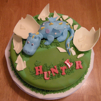 Hunter Dragon Inspired by MajkaZajka's cake. That dragon cake was too cute and was perfect for the couple this cake was made for. How mine is...