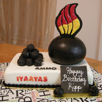 Iyaayas CSC with fudge filling, chocolate buttercream, white MMF and true black MMF, little ammo are cake truffles, flames are made of candy melts...