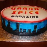 Urban Spice Magazine 2 layers of white cake covered in crusted buttercream and adorned with fondant cutout of Atlanta Skyline.