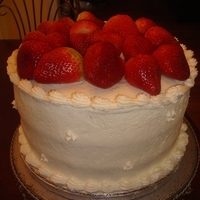 Strawberry Layer 3 Layer cake covered with butter cream and topped with fresh strawberries.