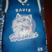 Geremy's Off To College Cake Football Jersey Cake covered in fondant and layered with edible image of the Huskies. Way to go Geremy!