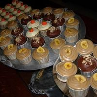 Three Cupcakes Banana with Penuche, Pumpkin with White Chocolate Cream Cheese, and Chocolate Hazelnut.