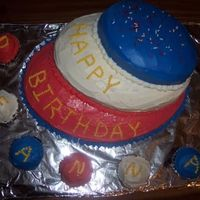 Red, White And Blue Lopsided Birthday Cake This was an attempt at a red white and blue lopsided birthday cake with cupcakes.