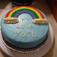 Rainbow Class Cake This is my first cake from WIlton I class. My daughter brought it in to her math class.