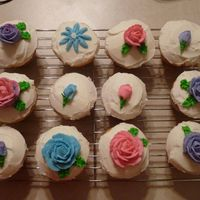 Flower Cupcakes Pink, purple, and blue flower cupcakes