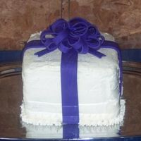 White Present With Purple Bow This cake was made for a bridel shower. A present cake with fondont bow.