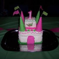 Pink And Green Princess Castle Cake I made this cake for my daughters 1st birthday. The bottom section was 4 layers, the top section was three layers, and came off easily for...