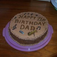 German Chocolate Bd Cake  German Chocolate cake with coconut pecan frosting in middle and sides. Chocolate BC is used for top and borders. fondant harmonica and...