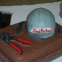 Chad's Groom's Cake Chocolate cake with cherry filling, chocolate buttercream frosting. Hard hat made from cake and covered with bc. tools are FBCT.