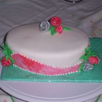 First Fondant Covered Cake This is a red velvet with bc filling and covered in fondant. Only a practic cake for home. First time doing fondant roses also. They are so...