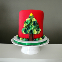 "Ruffled Fondant Christmas Tree A 5"" vanilla cake filled with chocolate ganache, frosted with espresso SMBC, and covered and in fondant. It was inspired by a favorite..."