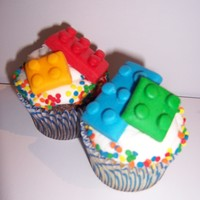 Lego Cupcakes chocolate and yellow cupcakes with buttercream frosting and fondant legos.