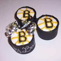Boston Bruins Cupcakes Birthday cupcakes for a huge Boston Bruins hockey fan. tried to make them look like hockey pucks with the Bruins logo on top. TFL