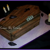 Wooden Casket cake made for a Halloween party i was really excited to do this cake because i have never gotten to do a Halloween cake. all fondant thanks...