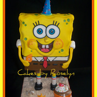 Sponge Bob Square Pants sponge bob cake. my dad made the support system to make him stand. it was so cute when i took the cake all my nephew could say was how did...