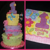 Hugs And Stitches   cake for a little girl turning one next to the napkin i was given for inspiration. all fondant thanks for looking,