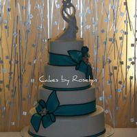Black And Turquoise   oval wedding cake the bride wanted simple and clean. all fondant thanks for looking