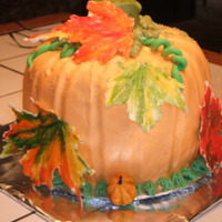 Pumpkin Shaped Cake Bottom is chocolate, chocolate chip and the top is spice cake. Covered in buttercream with white chocolate maple leaves.