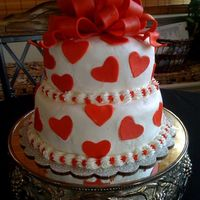 Anniversary Cake   This was my anniversary cake. Amaretto cake with pistachio filling. B/C frosting with amaretto. Fondant hearts & bow.